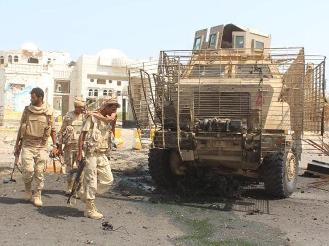 An army tank moves on a street in Yemen's southern port city of Aden.