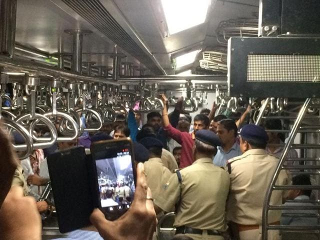 A commuter records Wednesday's incident in the Churchgate-Dahanu train at Virar station.