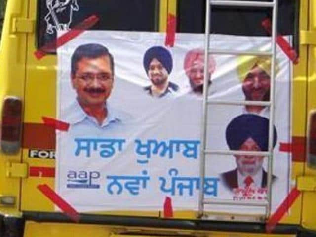 A school bus ferrying AAP supporters to a party rally in Moga district. The Punjabi poster says, 'Our dream, a new Punjab'.