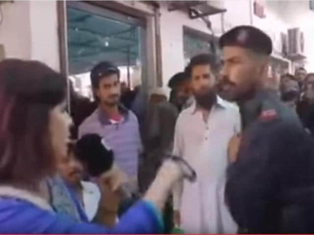 Framegrab from the video that showed a paramilitary guard slapping Pakistani TV reporter Saima Kanwal when she was doing a report on alleged wrongdoings at a government office in Karachi.
