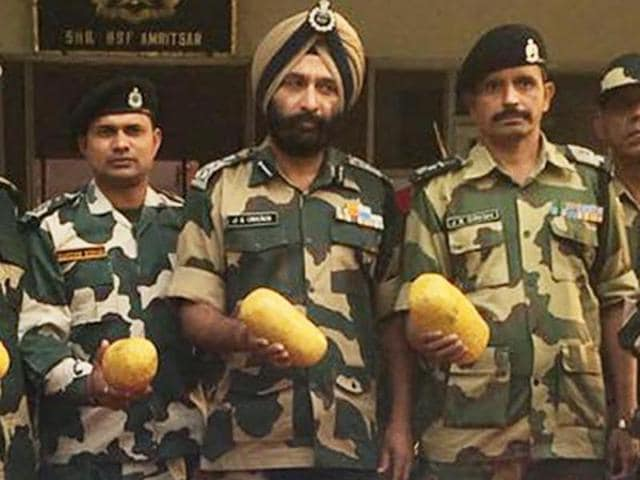 BSF officials with the heroin in Amritsar on Friday.