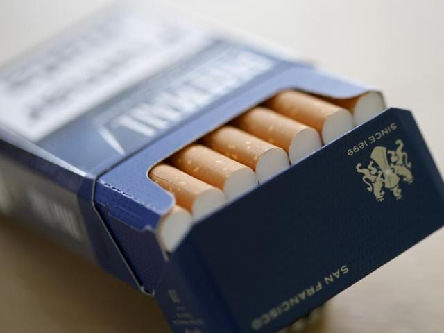 Lucky Strike cigarettes are seen during the manufacturing process in the British American Tobacco Cigarette Factory (BAT) in Germany, April 30, 2014.  BAT has offered a deal to buy Reynolds American Inc. that would create world's biggest tobacco company.