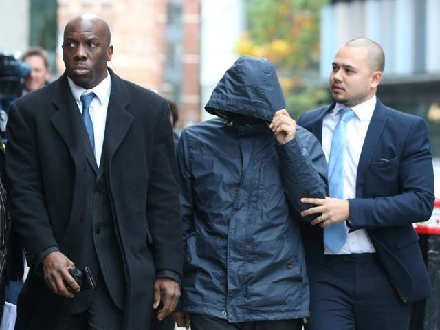 Mazher Mahmood (C), a British journalist known as the Fake Sheikh, is pictured as he arrives at the Old Bailey Central Criminal Court in central London, on Friday.