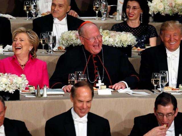 Democratic US presidential nominee Hillary Clinton (L-R), Archbishop of New York Cardinal Timothy Dolan and Republican US presidential nominee Donald Trump at the Alfred E Smith Memorial Foundation dinner in New York.