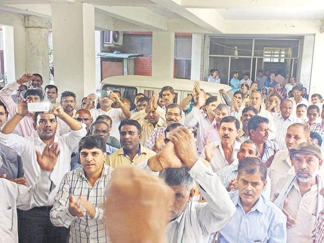 Over a hundred employees shouted slogans at the Sector 14 office and submitted a memorandum to the estate officer