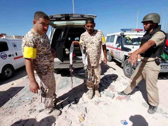 A fighter of Libyan forces allied with the UN-backed government holds an explosive belt left behind by Islamic State militants near the eastern frontline in Sirte, Libya, on Thursday.