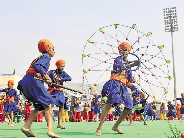 Students performing gatka and cultural dance during the 50th Punjabi Suba anniversary celebrations in Ludhiana on Thursday.