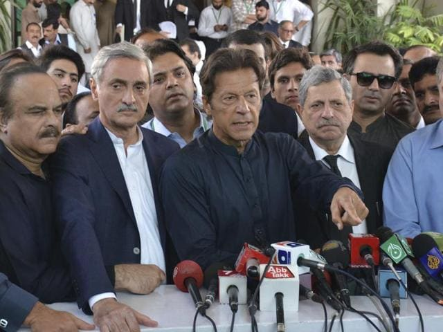Pakistan's cricketer turned politician Imran Khan, center, talks to journalists outside the Supreme Court in Islamabad on Thursday.
