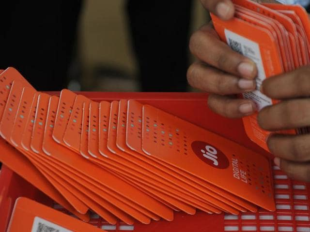 A staff member arranges Reliance Jio Infocomm 4G mobile service SIM cards at a store in Mumbai.