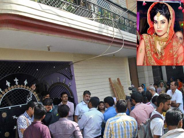 People gather after Lalita (inset), wife of national level Kabaddi player Rohit Kumar was found hanging at her home in Nangloi, New Delhi.