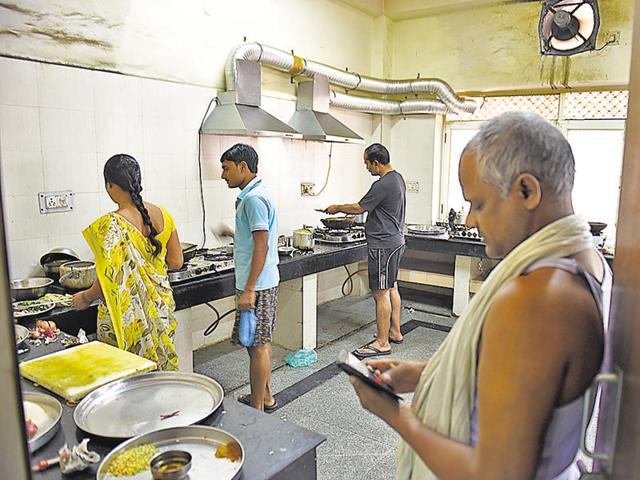The men took to knives and ladles to quell their hunger as the contractual kitchen workers started a strike on Friday, claiming that they haven't been paid salaries.