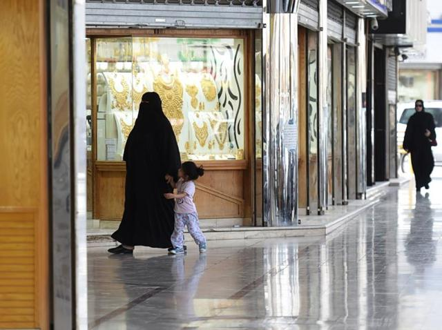 Saudi women walk past jewellery shops at Tiba market in Riyadh. Since 2014 global oil prices have collapsed by more than half, leaving Saudi Arabia with a record deficit last year.
