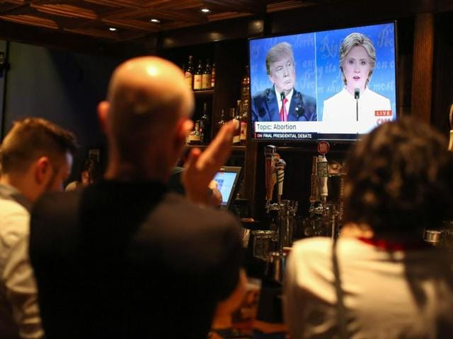 People watch the third US presidential debate between Hillary Clinton and Donald Trump at Murphy's Tap House in uptown Charlotte, North Carolina.
