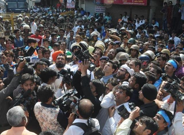 Mediapersons outside the DC office in Indore where the NSUI workers had laid a siege.