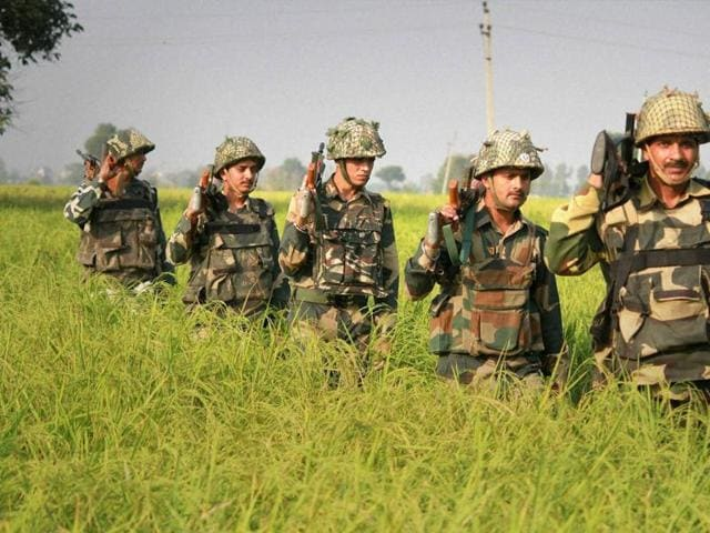 Border Security Force (BSF) men patrol near International Border in RS Pura Sector in Jammu on Wednesday.