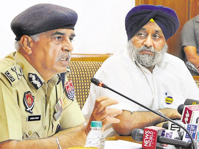 Deputy chief minister Sukhbir Badal and DGP Suresh Arora at a press conference in Chandigarh on Friday.