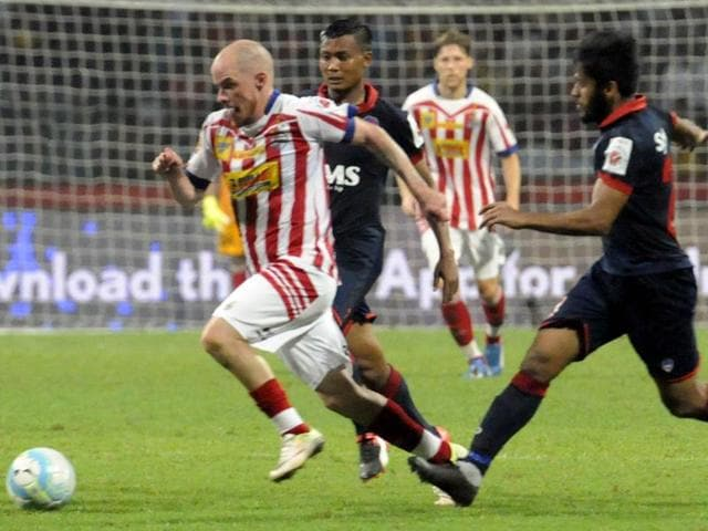 Iain Hume of ATK is being chased by Delhi Dynamos defenders during the ISL match in Kolkata.
