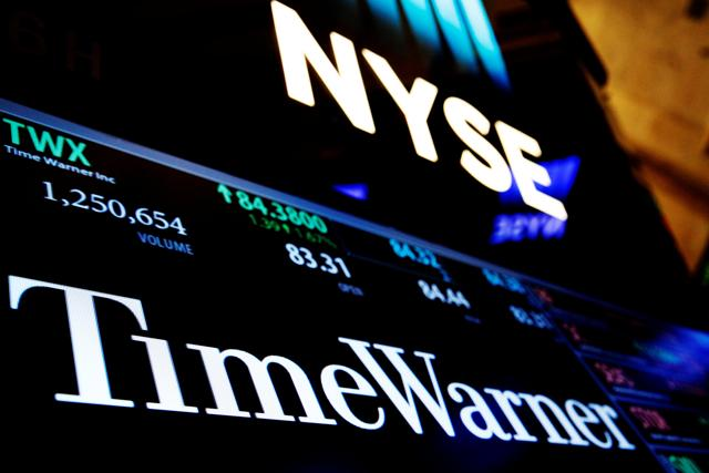 Ticker and trading information for media conglomerate Time Warner Inc. is displayed at the post where it is traded on the floor of the NYSE.