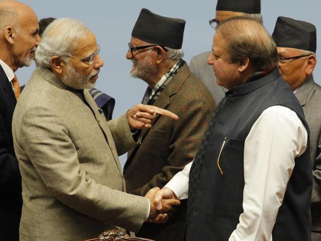 This file photo shows Prime Minister Narendra Modi with  Pakistan's Prime Minister Nawaz Sharif.