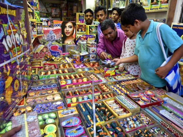 Delhiites buy fireworks from a shop near Jama Masjid on Saturday.