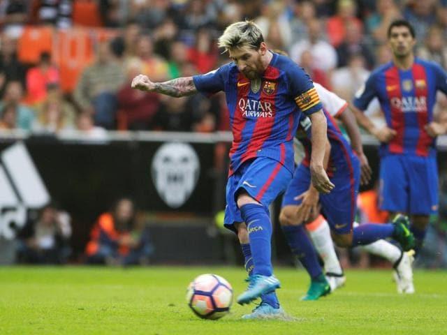 Barcelona's Lionel Messi celebrates scoring his second goal.