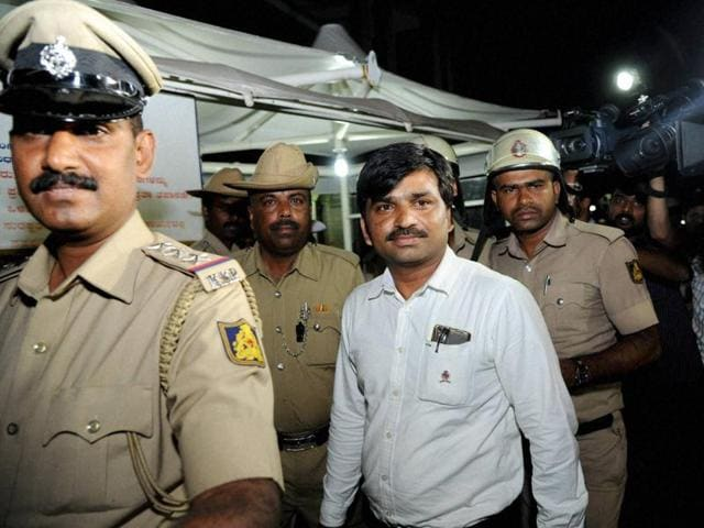 Bengaluru police taking away Siddharth, who was held with Rs 2.4 crore in his car, during a routine security check near Vidhan Soudha in Bengaluru on Friday.