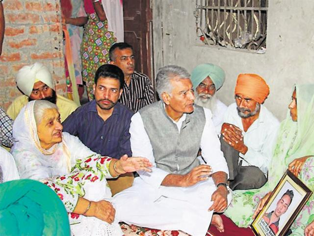 Congress leader Sunil Kumar Jakhar with the family of 'murdered' Dalit youth Ajay Singh in Muktsar on Friday.
