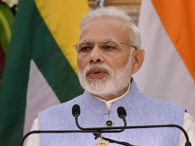 Prime Minister Narendra Modi speaks at a press conference after a meeting at Hyderabad House in New Delhi.