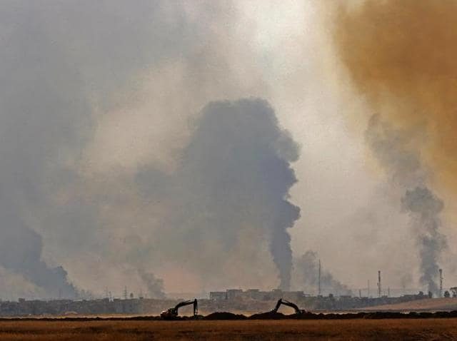 A picture taken on October 18, 2016 from the village of Shaqouli shows smoke billowing from the city of Nineveh as Iraqi forces take part in an operation against the Islamic State (IS) group jihadists.