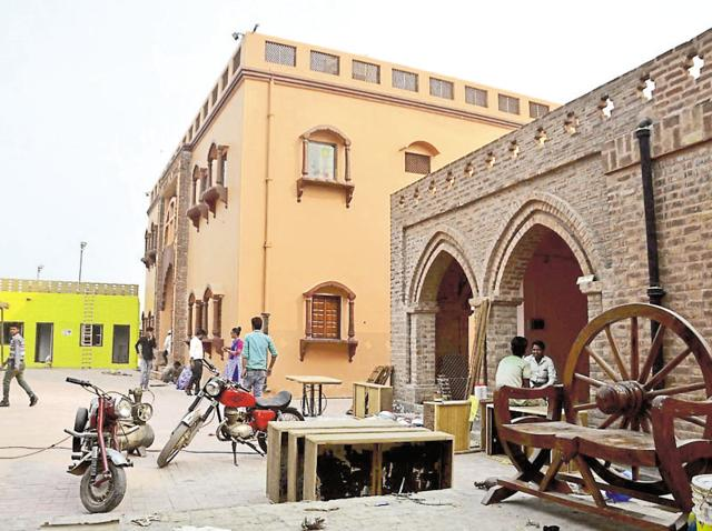 This is how the street of 'Sadda Pind' look. Workers are giving final touches to the heritage village to be inaugurated on November 1 in Amritsar.