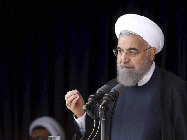 In this photo released by official website of the office of the Iranian Presidency, President Hassan Rouhani speaks to a crowd during a visit to the central city of Arak, Iran.