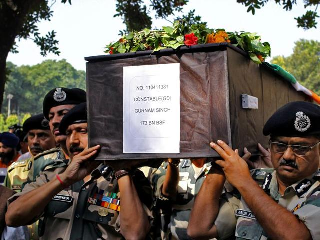 Additional DG Arun Kumar (R) and Inspector General D.K. Uphadayaya of Border Security Force (BSF) carry the coffin of Gurnam Singh, who succumbed to injuries sustained in an exchange of fire with Pakistani troops at the border,  on the outskirts of Jammu on Sunday.