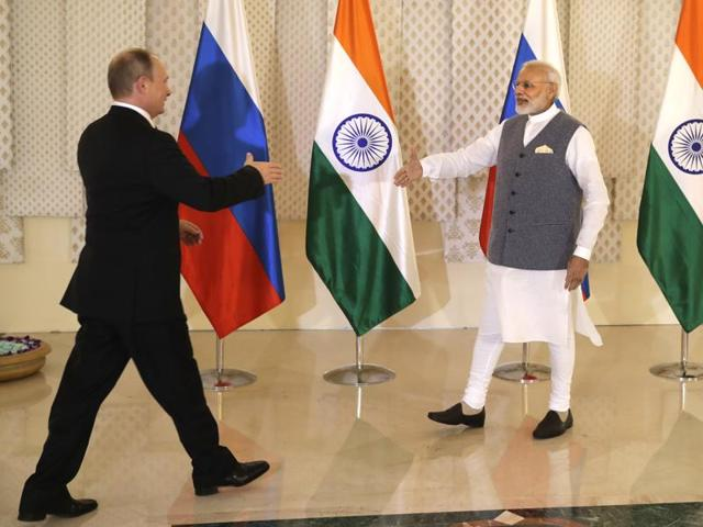 Prime Minister Narendra Modi, right, shakes hand with Russian President Vladimir Putin prior to their annual bilateral meeting, on the sidelines of the BRICS summit on October 15, 2016.
