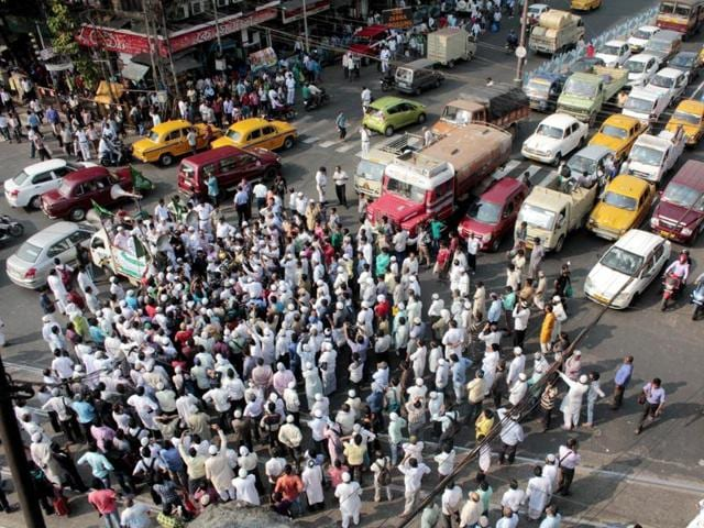 A Muslim organization blocks the road and protest against Uniform civil code at Esplanade on Friday. Three Trinamool Congress MPs participated in the rally.