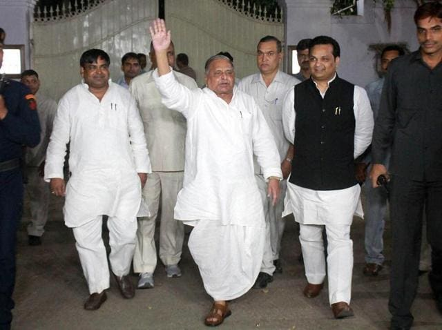 Samajwadi Party chief Mulayam Singh Yadav waves to his party workers as he comes out after a meeting at his residence in Lucknow on Sunday.