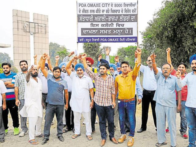 Residents of PDA-Omaxe city holding a protest in Patiala on Saturday.