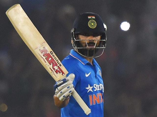 Virat Kohli celebrtes his century in the third ODI match against New Zealand in Mohali.