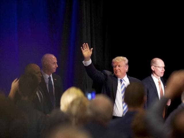 Republican Presidential nominee Donald J. Trump waves to supporters after holding an event at the Eisenhower Hotel and Conference Center October 22 in Gettysburg, Pennsylvania.
