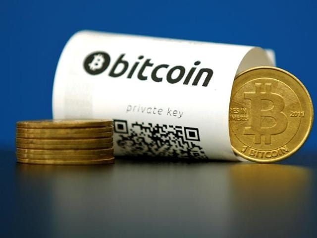 A Bitcoin (virtual currency) paper wallet with QR codes and a coin are seen in an illustration picture taken at La Maison du Bitcoin in Paris, France on May 27, 2015.