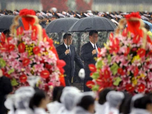 With the exception of China's President Xi Jinping, right, and Premier Li Keqiang, the top leadership of the Communist Party will be changed after a four-day meeting in autumn next year.