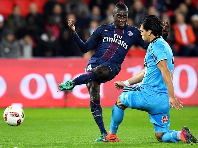 Paris Saint-Germain's Blaise Matuidi (L) kicks the ball as Olympique de Marseille's Karim Rekik looks to intercept.