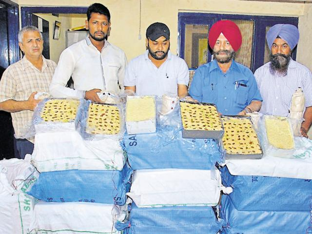 Health officials with the spurious sweets seized during a raid in Amritsar on Sunday.