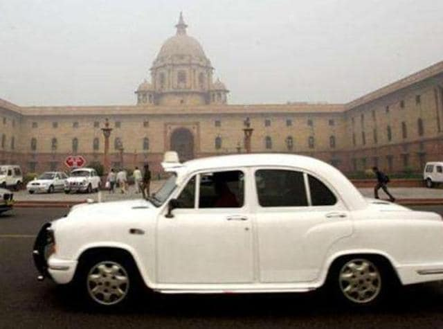 An ambassador car drives past the country's seat of power South Block, which houses the defence ministry.(AP Photo)