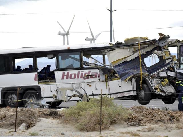 The front of the bus crumpled into the semi-truck's trailer and debris was scattered across the key route through Southern California.