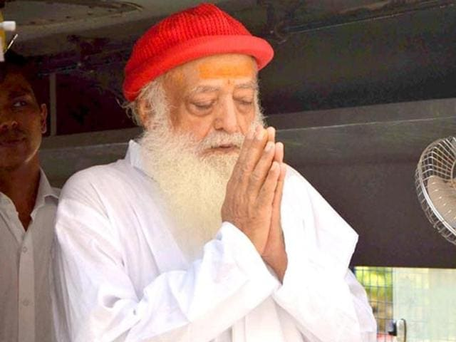 Asaram Bapu greets his supporters as he arrives for a hearing at the court, in Jodhpur, Rajasthan.