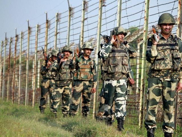 BSF personnel patrol along the fence at International Border in RS Pura Sector in Jammu.