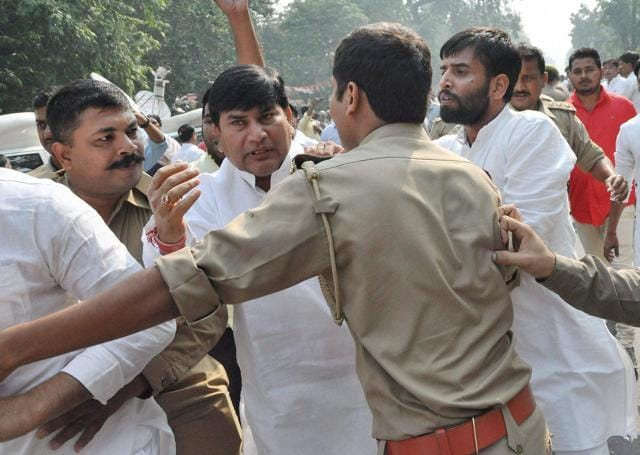 Police intervene after supporters of UP chief minister Akhilesh Yadav and UP state president Shivpal Singh Yadav clash near the party office in Lucknow on Monday.