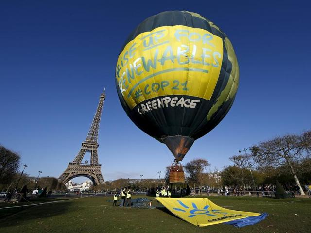 Greenpeace activists fly a hot air balloon depicting the globe next to the Eiffel Tower ahead of the 2015 Paris Climate Conference, known as the COP21 summit, in Paris, France, November 28, 2015.