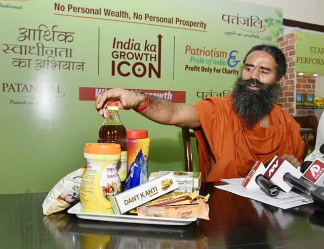 Baba Ramdev with Patanjali products.
