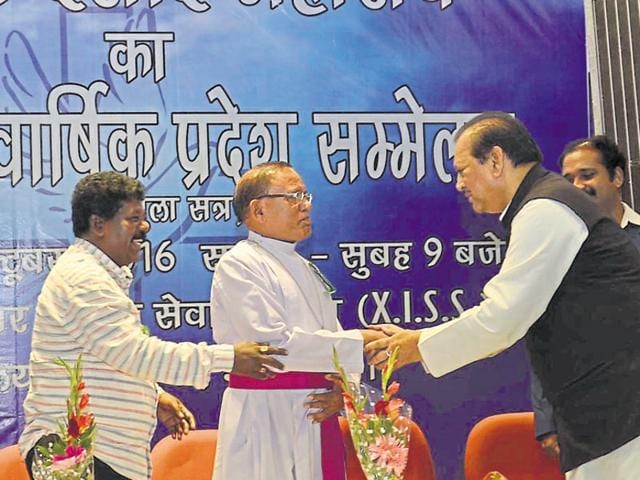 Congress leader Subodh Kant Sahai (R) is being welcomed by Father Topno during the convention in Ranchi.